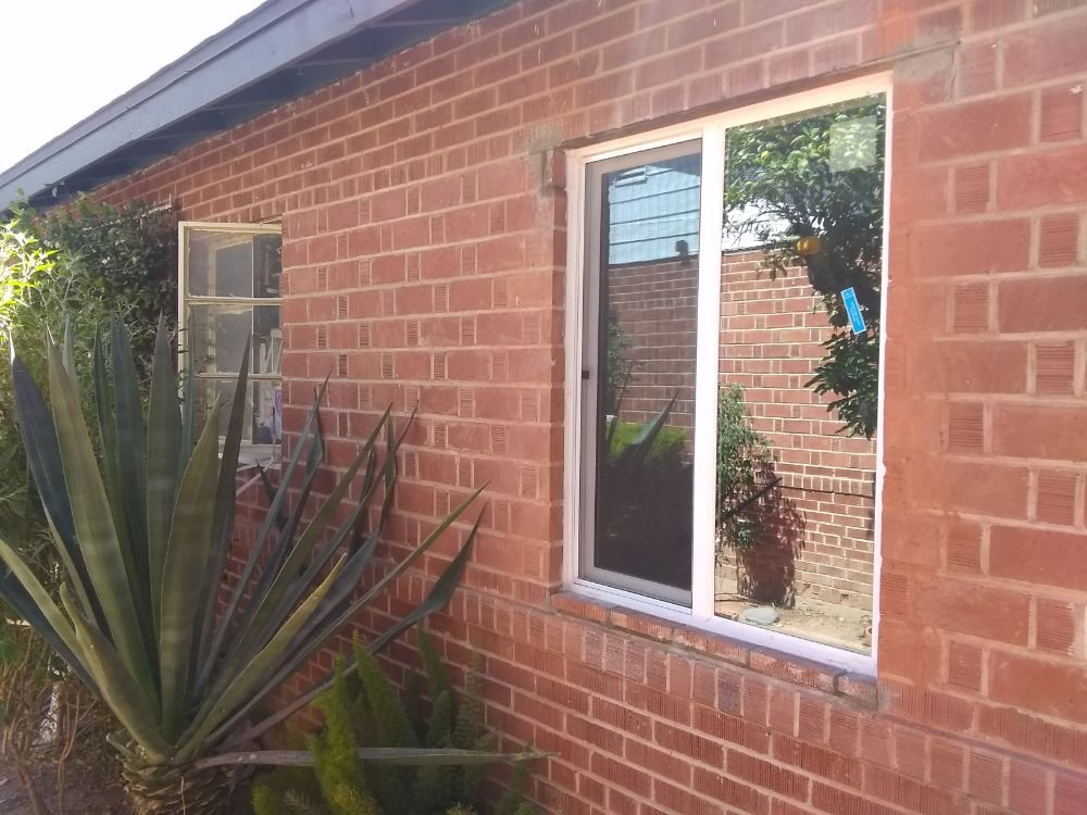 Replacement window installation in a red brick wall
